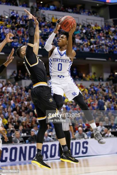 De'Aaron Fox of the Kentucky Wildcats shoots against Landry Shamet of the Wichita State Shockers in the first half during the second round of the...