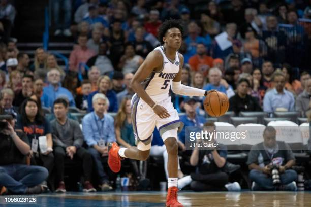 De'Aaron Fox of the Sacramento Kings brings the ball up court against the Oklahoma City Thunder during the second half of a NBA game at the...