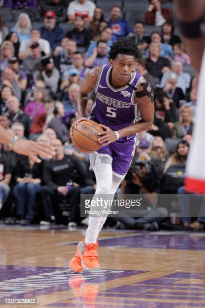 De'Aaron Fox of the Sacramento Kings brings the ball up the court against the Toronto Raptors on March 8 2020 at Golden 1 Center in Sacramento...