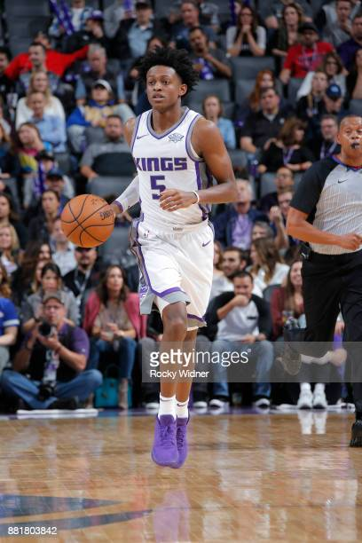 De'Aaron Fox of the Sacramento Kings brings the ball up the court against the Los Angeles Clippers on November 25 2017 at Golden 1 Center in...
