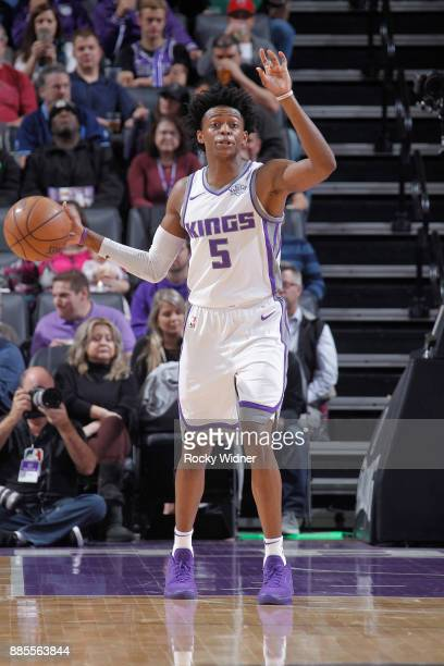 De'Aaron Fox of the Sacramento Kings brings the ball up the court against the Milwaukee Bucks on November 28 2017 at Golden 1 Center in Sacramento...