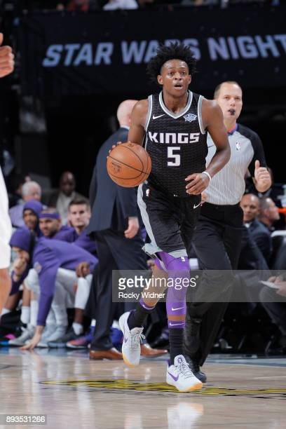 De'Aaron Fox of the Sacramento Kings brings the ball up the court against the Phoenix Suns on December 12 2017 at Golden 1 Center in Sacramento...