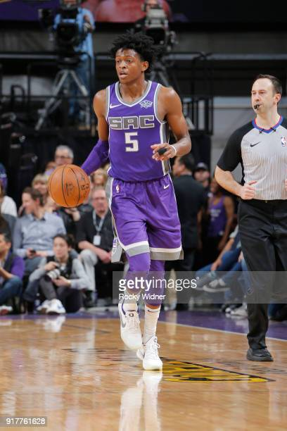 De'Aaron Fox of the Sacramento Kings brings the ball up the court against the Dallas Mavericks on February 3 2018 at Golden 1 Center in Sacramento...