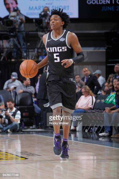 De'Aaron Fox of the Sacramento Kings brings the ball up the court against the Golden State Warriors on March 31 2018 at Golden 1 Center in Sacramento...