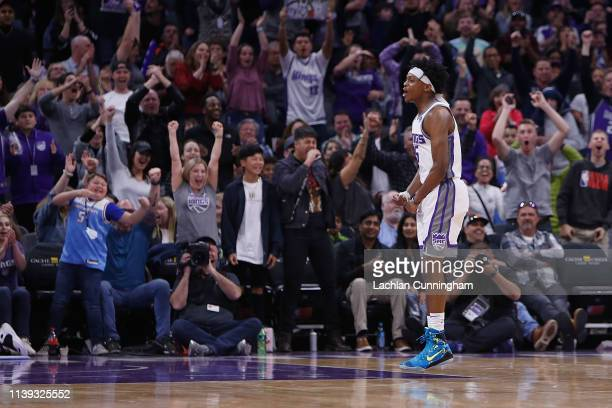 De'Aaron Fox of the Sacramento Kings celebrates after a basket against the Phoenix Suns at Golden 1 Center on March 23, 2019 in Sacramento,...