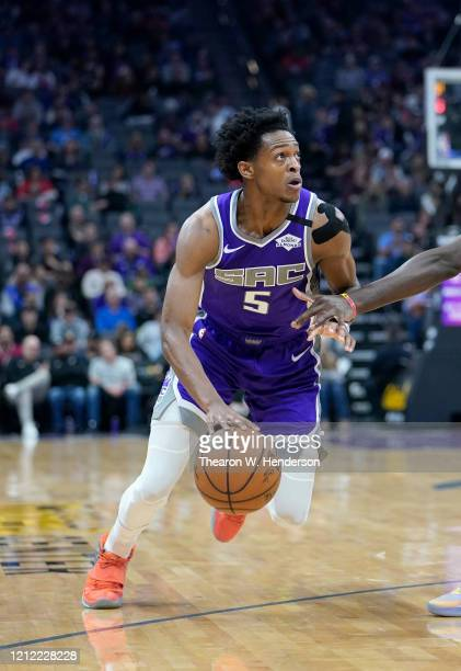 De'Aaron Fox of the Sacramento Kings dribbles the ball against the Toronto Raptors during the first half of an NBA basketball game at Golden 1 Center...