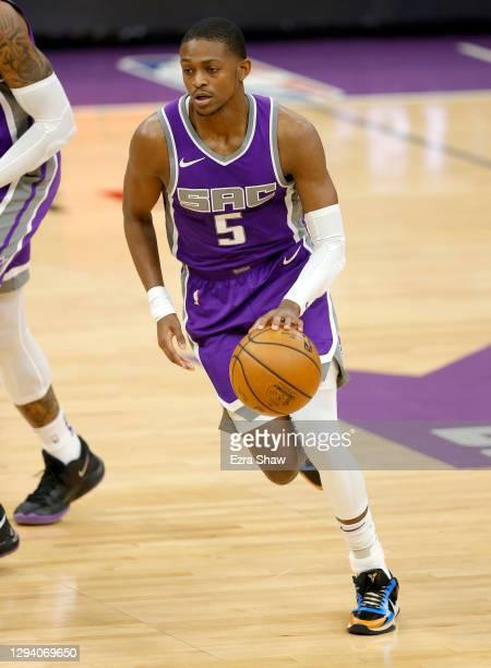 De'Aaron Fox of the Sacramento Kings dribbles the ball against the Denver Nuggets at Golden 1 Center on December 29, 2020 in Sacramento, California....