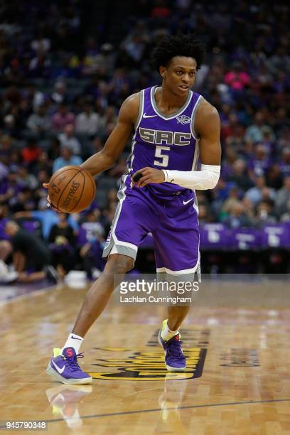 De'Aaron Fox of the Sacramento Kings dribbles the ball up court against the Houston Rockets at Golden 1 Center on April 11 2018 in Sacramento...