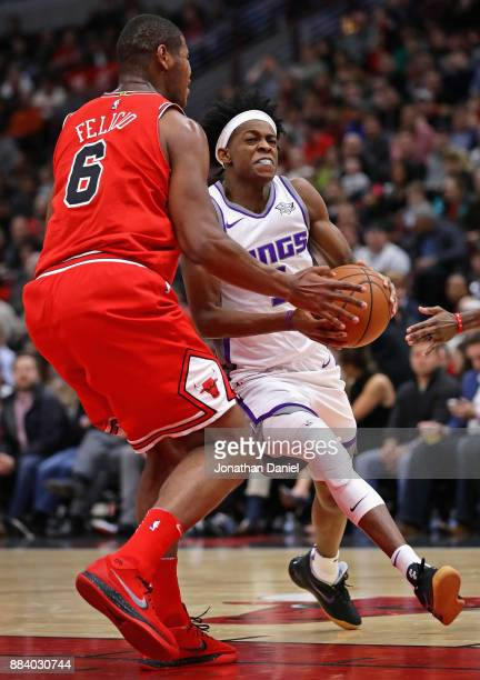 De'Aaron Fox of the Sacramento Kings drives against Cristiano Felicio of the Chicago Bulls at the United Center on December 1 2017 in Chicago...
