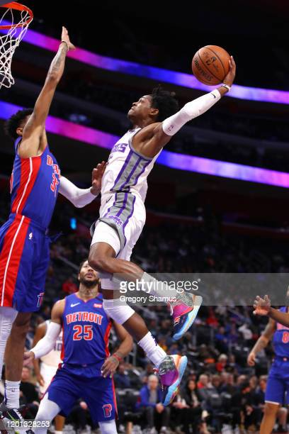 De'Aaron Fox of the Sacramento Kings drives to the basket against Christian Wood of the Detroit Pistons during the first half at Little Caesars Arena...