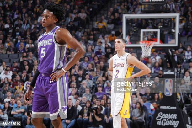 De'Aaron Fox of the Sacramento Kings faces off against Lonzo Ball of the Los Angeles Lakers on November 22 2017 at Golden 1 Center in Sacramento...
