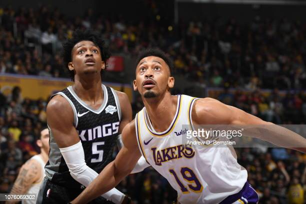 De'Aaron Fox of the Sacramento Kings fights for position with Johnathan Williams of the Los Angeles Lakers on December 30 2018 at STAPLES Center in...