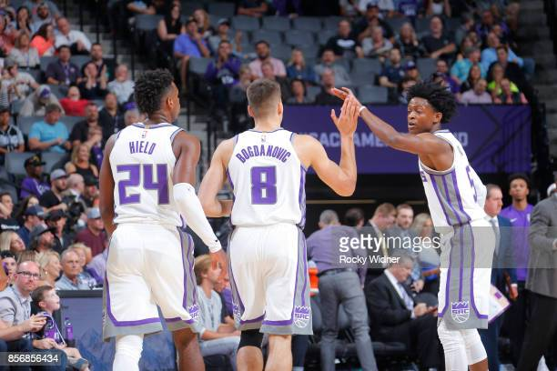 De'Aaron Fox of the Sacramento Kings give high fives to teammates during the preseason game against the San Antonio Spurs on October 2 2017 at Golden...