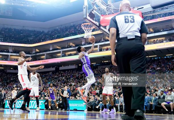 De'Aaron Fox of the Sacramento Kings goes in for a layup against the Toronto Raptors during the first half of an NBA basketball game at Golden 1...