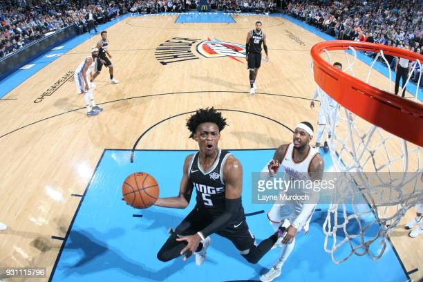 De'Aaron Fox of the Sacramento Kings goes to the basket against the Oklahoma City Thunder on March 12 2018 at Chesapeake Energy Arena in Oklahoma...