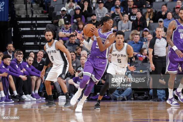 De'Aaron Fox of the Sacramento Kings handles the ball against Dejounte Murray of the San Antonio Spurs on January 8 2018 at Golden 1 Center in...
