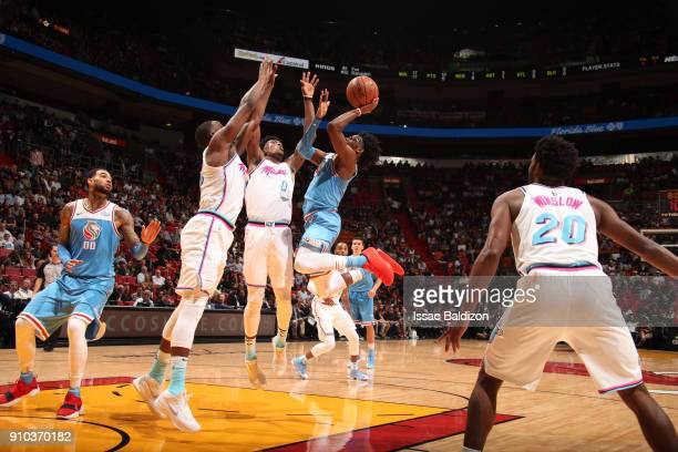 De'Aaron Fox of the Sacramento Kings handles the ball against the Miami Heat on January 25 2018 at AmericanAirlines Arena in Miami Florida NOTE TO...