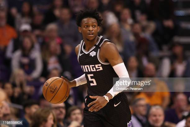 De'Aaron Fox of the Sacramento Kings handles the ball against the Phoenix Suns during the NBA game at Talking Stick Resort Arena on January 07 2020...