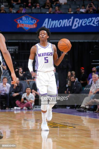 De'Aaron Fox of the Sacramento Kings handles the ball against the San Antonio Spurs during the preseason game on October 2 2017 at Golden 1 Center in...