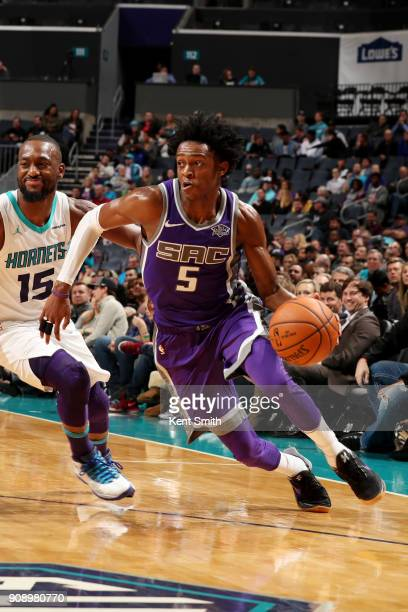 De'Aaron Fox of the Sacramento Kings handles the ball during the game against the Charlotte Hornets on January 22 2018 at Spectrum Center in...