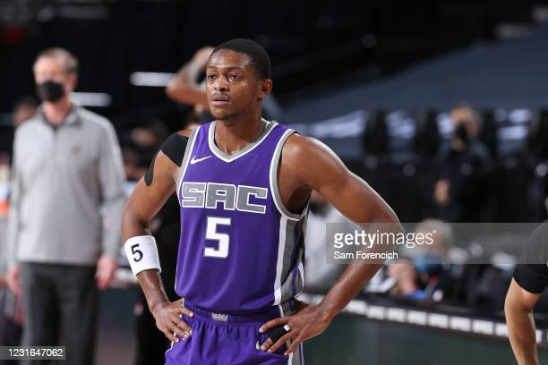De'Aaron Fox of the Sacramento Kings looks on against the Portland Trail Blazers on March 4, 2021 at the Moda Center Arena in Portland, Oregon. NOTE...