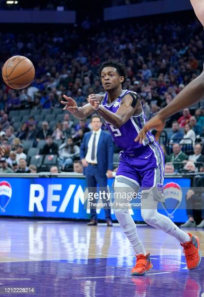 De'Aaron Fox of the Sacramento Kings passes the ball against the Toronto Raptors during the first half of an NBA basketball game at Golden 1 Center...