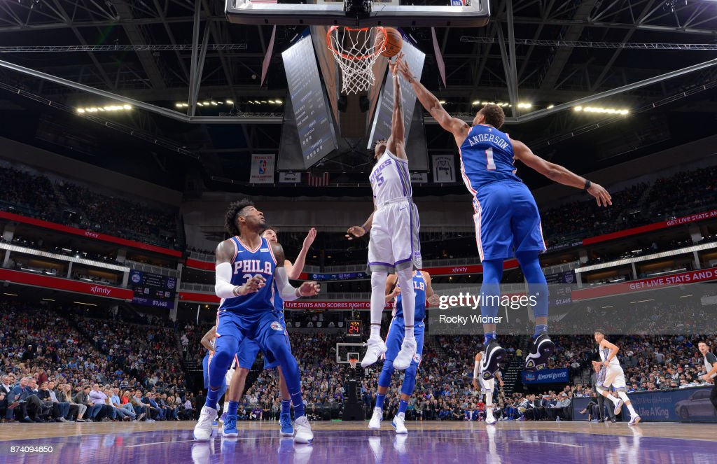 De'Aaron Fox of the Sacramento Kings rebounds against Justin