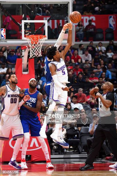 De'Aaron Fox of the Sacramento Kings rebounds the ball during the game against the LA Clippers on January 13 2018 at STAPLES Center in Los Angeles...