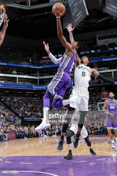 De'Aaron Fox of the Sacramento Kings shoots a layup against Dejounte Murray of the San Antonio Spurs on January 8 2018 at Golden 1 Center in...
