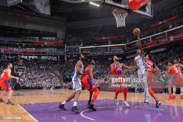 De'Aaron Fox of the Sacramento Kings shoots a layup against Derrick Rose of the Detroit Pistons on March 1 2020 at Golden 1 Center in Sacramento...