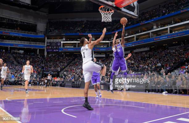 De'Aaron Fox of the Sacramento Kings shoots a layup against the San Antonio Spurs on January 8 2018 at Golden 1 Center in Sacramento California NOTE...