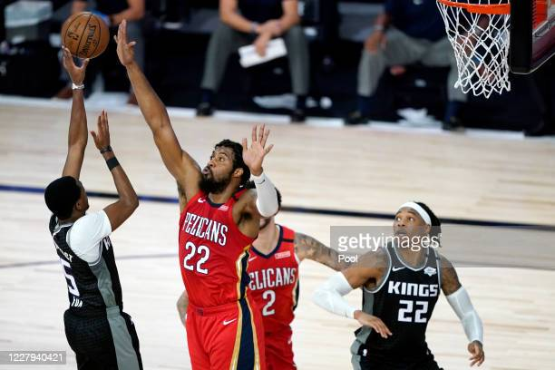 De'Aaron Fox of the Sacramento Kings shoots against Derrick Favors of the New Orleans Pelicans during the second half of an NBA basketball game at HP...