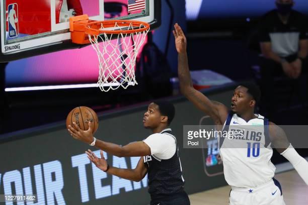 De'Aaron Fox of the Sacramento Kings shoots against Dorian Finney-Smith of the Dallas Mavericks in the first half of a NBA basketball game at HP...