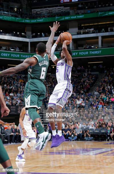 De'Aaron Fox of the Sacramento Kings shoots against Eric Bledsoe of the Milwaukee Bucks on November 28 2017 at Golden 1 Center in Sacramento...