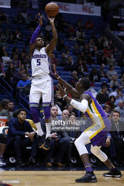 De'Aaron Fox of the Sacramento Kings shoots over Ian Clark of the New Orleans Pelicans during the second half at the Smoothie King Center on January...