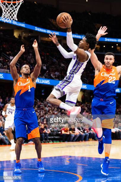 De'Aaron Fox of the Sacramento Kings shoots over Rodney Hood and Larry Nance Jr #22 of the Cleveland Cavaliers during the first half at Quicken Loans...