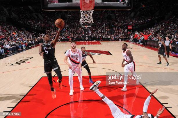 De'Aaron Fox of the Sacramento Kings shoots the ball during the game against the Portland Trail Blazers on October 20, 2021 at the Moda Center Arena...