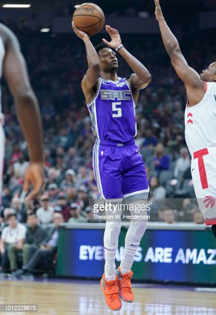 De'Aaron Fox of the Sacramento Kings shoots the ball up court against the Toronto Raptors during the first half of an NBA basketball game at Golden 1...
