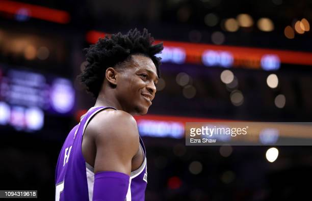 De'Aaron Fox of the Sacramento Kings smiles while standing on the court during their game against the Portland Trail Blazers at Golden 1 Center on...