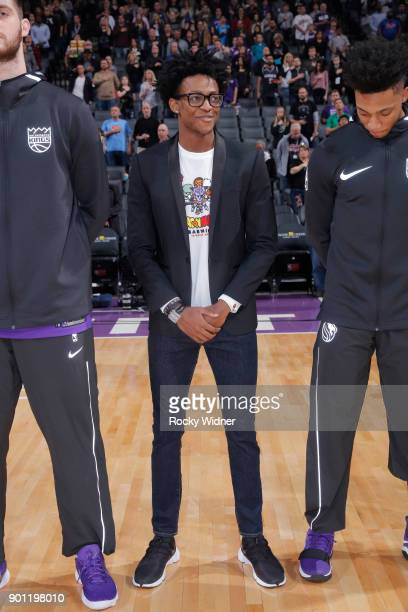 De'Aaron Fox of the Sacramento Kings stands for the national anthem of the game against the Memphis Grizzlies on December 31 2017 at Golden 1 Center...