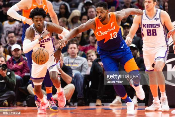 De'Aaron Fox of the Sacramento Kings steals from Tristan Thompson of the Cleveland Cavaliers during the first half at Quicken Loans Arena on December...