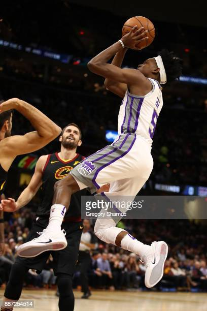 De'Aaron Fox of the Sacramento Kings takes a shot next to Kevin Love of the Cleveland Cavaliers during the first half at Quicken Loans Arena on...