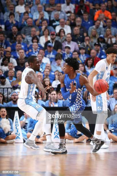 De'Aaron Fox of the University of Kentucky Wildcats passes the ball against Theo Pinson of the University of North Carolina Tar Heels during the 2017...
