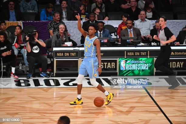 De'Aaron Fox of the USA Team dribbles up court against the World Team during the Mountain Dew Kickstart Rising Stars Game during AllStar Friday Night...