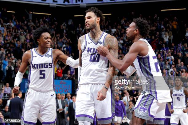 De'Aaron Fox Willie CauleyStein and Buddy Hield of the Sacramento Kings react during the game against the Indiana Pacers on December 1 2018 at Golden...