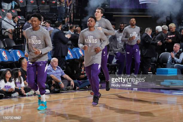 De'Aaron Fox Yogi Ferrell Nemanja Bjelica and Kent Bazemore of the Sacramento Kings run onto the court prior to the game against the New Orleans...