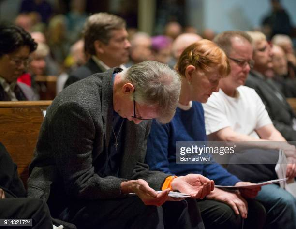 TORONTO ON FEBRUARY 4 Deacon Brian Birkby bows in prayer with church volunteers Marilyn Byers and James Brown during prayers at The Metropolitan...