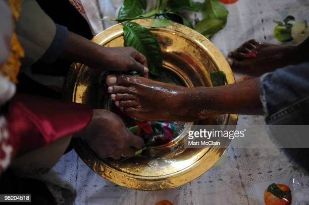 Deacon Buruk Kidane has his feet and hands washed by Reverend Gebrekiros at the Ethiopian Orthodox Church April 1 2010 in Denver Colorado Members of...
