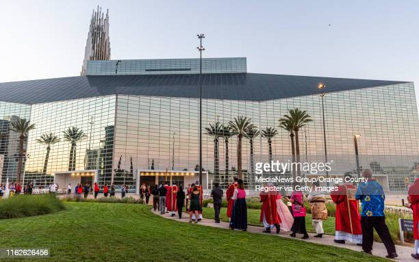 Deacons carrying relics from martyrs and saints walk in a procession to Christ Cathedral during the Solemn Evening Prayer and Vigil with the Relics...