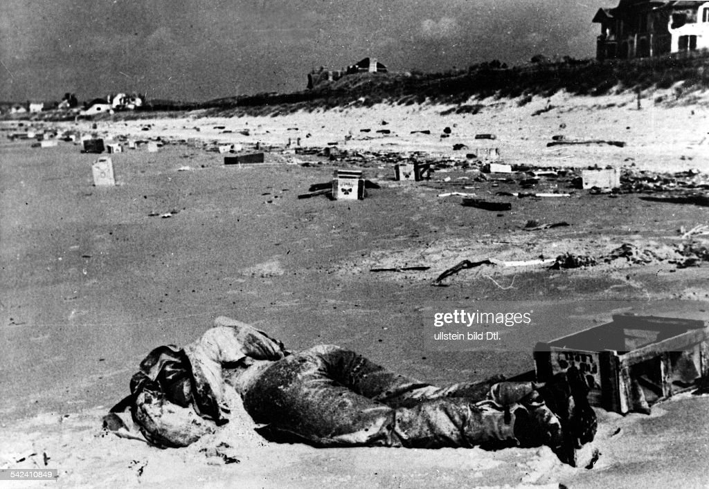 dead allied soldier and war material on the normandy coast june